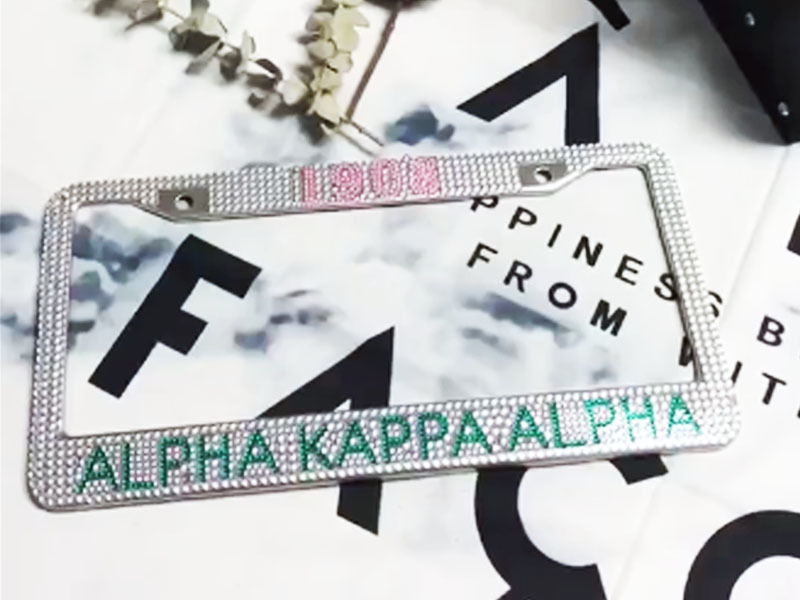 AKA pink and green rhinestone license plate frames